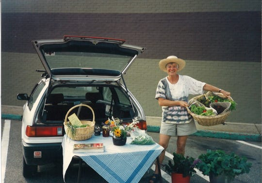 Renate Rikker arrives at the Valley Garden Market in 1996 with lettuce grown from her Black Mountain home.