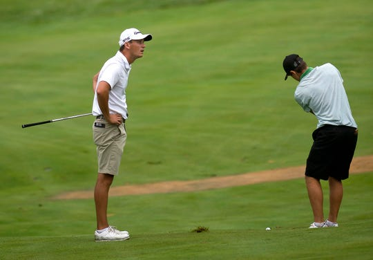Drake Hull , left,reacts to his third shot at the par-5 13th hole before Bryson Richards hits his own at Rutland Country Club during the final round of the 2019 Vermont Amateur championship on Thursday, July 11.