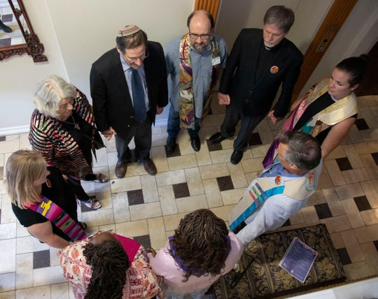 Clergy from various denominations gather to bless an Austin clinic where abortions are performed.