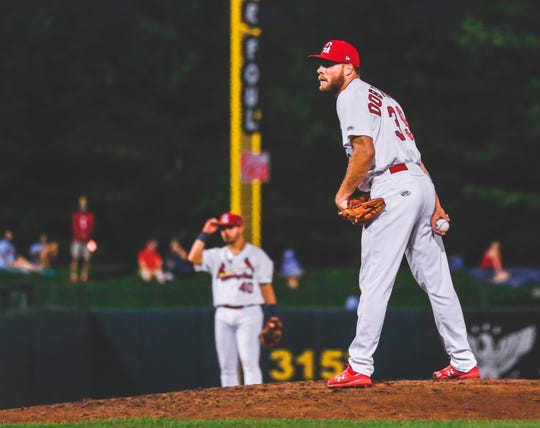 Delsea graduate Bryan Dobzanski peers in while pitching for the Springfield Cardinals, the St. Louis Cardinals Double-A affiliate, on July 11.