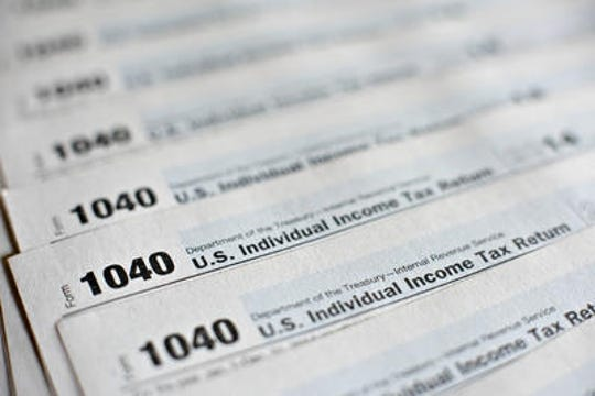 A Camden woman is accused of filing fraudulent tax returns.