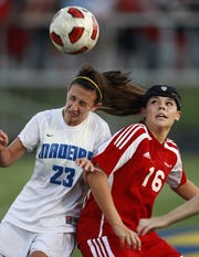 Indian Hill's Liz Slattery, right, battles for the ball with Madeira's Tori Powers during their soccer game Sept. 21, 2011.
