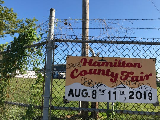 A graffiti-laced sign at the Hamilton County Fairgrounds advertises this year's fair.