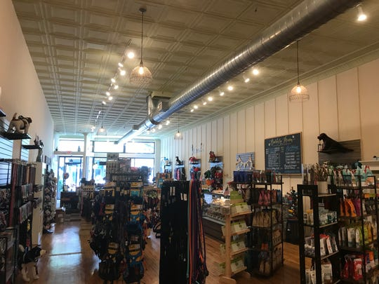 The new 5,000-square-foot location now offers grooming services and a wider variety of products.