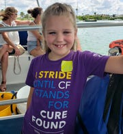 "Laci Taylor, 6, of Warsaw recently went to Clearwater Marine Aquarium in Florida and saw Winter the dolphin from the movie ""Dolphin Tale."" She has cystic fibrosis and the trip was possible through the Casey Cares Foundation."
