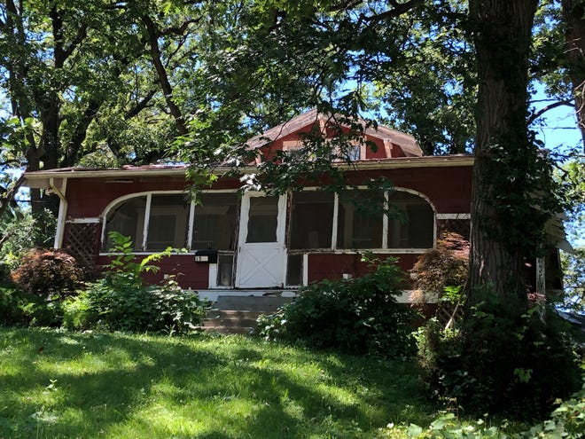 This unoccupied home in Beaverdale has been the subject of numerous complaints to city officials.