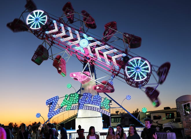 Riders spin in circles on The Zipper during the opening night of SummerFest in Ankeny on July 11.