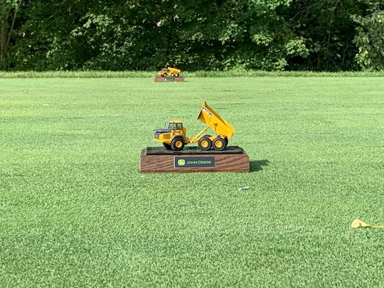 A replica of a 460E dump truck serves as one of the unique tee marker's at the 2019 John Deere Classic