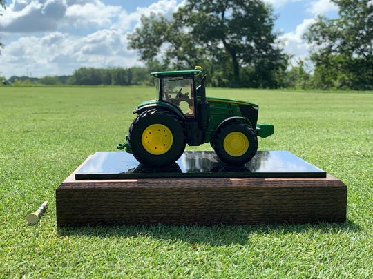 A replica 7310R tractor serves as one of the unique tee markers at the 2019 John Deere Classic.