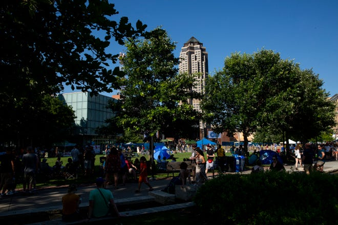 People walk around as music begins at the 80/35 music festival on Friday, July 12, 2019, in Des Moines.