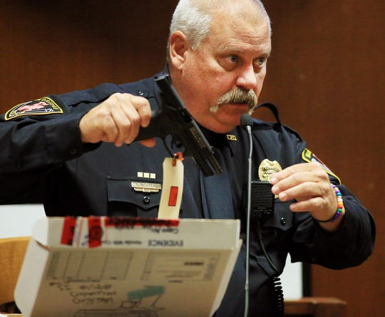 Bruce Schwarz, Eldridge police officer and school resource officer in the North Scott School District, talks about examining the loaded black Smith & Wesson .22-caliber gun when he arrived at the North Scott Junior High School in Eldridge Aug. 31, 2018 during the first day of testimony Thursday, July 11, 2019.