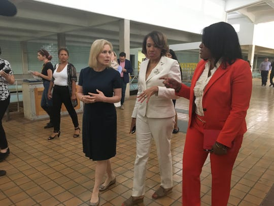 From left, U.S. Sen. Kirsten Gillibrand, D-N.Y.,  Flint Mayor Karen Weaver and Flint Public Health Adviser Pamela Pugh tour the now-inactive Flint water plant during Gillibrand's visit to Flint on Friday, July 12, 2019.