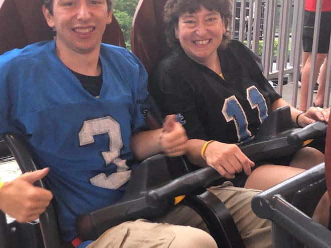 Justin, left, and Denise Doede eagerly sit awaiting to ride the Steel Curtain at Kennywood Park in West Mifflin, Penn. on July 12, 2019.