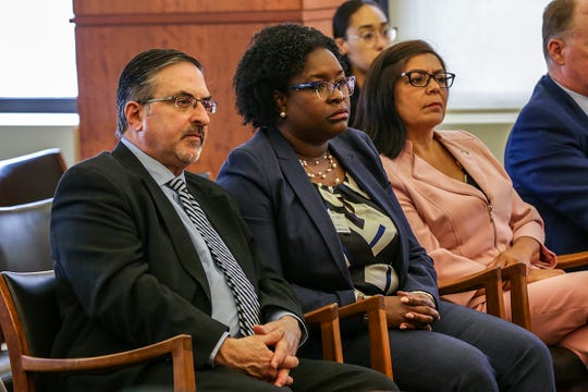 Michale Busuito, Dana Thompson, and Sandra  Hughes O'Brien are three of the four members of the Wayne State Board of Governors suing the other four members of the board, alleging the four being sued held an illegal meeting and are seen in the court of claims in Detroit on Friday, July 12, 2019.