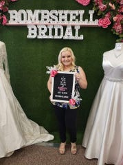 "Rita Wojnowski poses with her new wedding dress at Bombshell Bridal. Wojnowski turned to Bombshell Bridal when Bella Rose Bridal Boutique in Shelby Township shuttered its doors with nothing but a sign on the door saying it had closed ""due to an emergency beyond our control."""