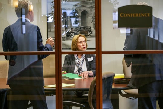 Wayne State University Board of Governors Board Member Marilyn Kelly consults with her lawyers in a private conference during a break from the court of claims hearing to decide if they held an illegal meeting in Detroit on Friday, July 12, 2019.