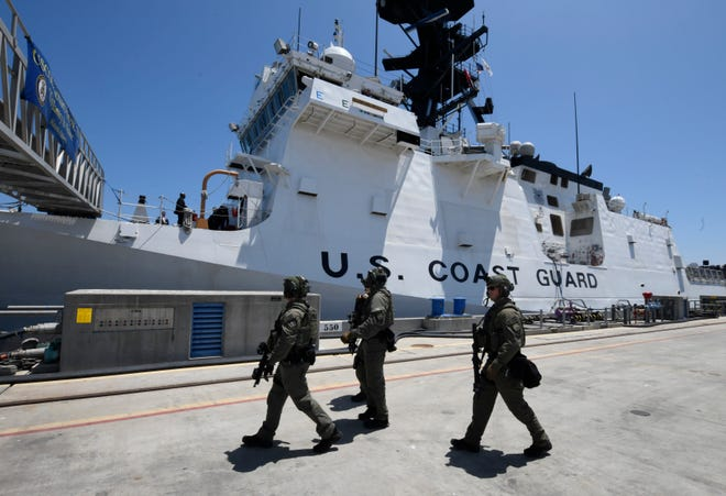 U.S. Navy security personnel patrol the dock during a visit by Vice President Mike Pence to the U.S. Coast Guard Cutter Munro, Thursday, July 11, 2019, in Coronado, Calif.