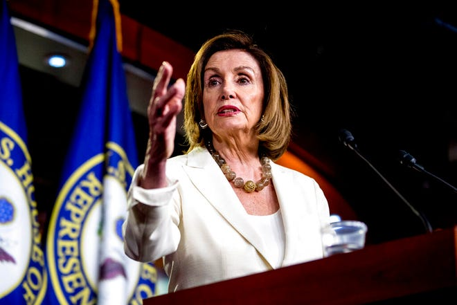 """House Speaker Nancy Pelosi of Calif. meets with reporters on Capitol Hill in Washington, Thursday, July 11, 2019. Republican Donald Trump is defending top Democrat Pelosi and says Rep. Alexandria Ocasio-Cortez of New York should treat Pelosi """"with respect"""" – in Trump's words."""
