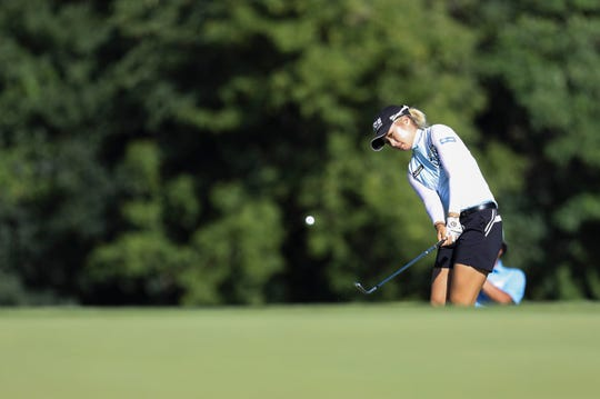 Jeongeun Lee6 chips to the green on the 18th hole during the second round of the Marathon LPGA Classic on Friday.