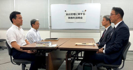 Jeon Chansu, right, manager of South Korean Trade Security Section at Ministry of Industry, Trade and Resources, and Jun Iwamatsu, left, director of Japanese Trade Control Policy Division, Trade Control Department, meet to discuss Japan's tightening of controls on high-tech exports to South Korea, in Tokyo, Japan, Friday, July 12, 2019.