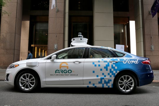 A prototype of Ford and Argo AI's self-driving car is displayed outside of Friday's news conference in New York.