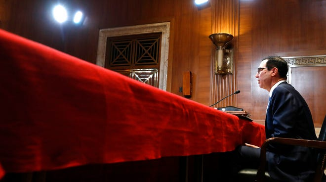 In this May 15, 2019, file photo Treasury Secretary Steve Mnuchin testifies during a hearing on Capitol Hill. In a letter Friday, July 12, to House and Senate leaders, Mnuchin told congressional leaders that Congress should raise the debt ceiling before leaving for its August recess. He says he could run out of maneuvering room to avoid an unprecedented default on the national debt before lawmakers return.