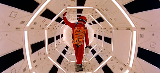 "This image released by Warner Bros. Pictures shows Keir Dullea in a scene from the 1968 film, ""2001: A Space Odyssey."" Space exploration was then an exciting possibility, but one far from realization. Stanley Kubrick and science-fiction author Arthur C. Clarke, convinced the moon was only the start, began to toil on a script together. It would be five years before astronauts landed on the moon, on July 20, 1969. Kubrick took flight sooner. ""2001: A Space Odyssey"" opened in theaters April 3, 1968."