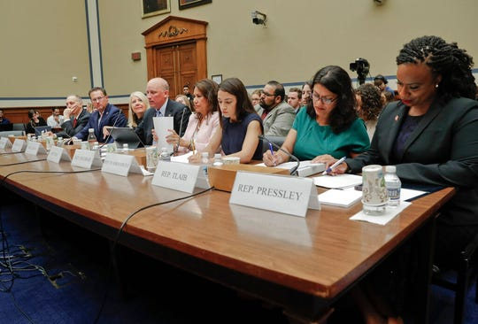 From l-r., Rep. Andy Biggs, R-Ariz., Rep. Michael Cloud, R-Texas, Rep. Debbie Lesko, R-Ariz.,Rep. Chip Roy, R-Texas, Rep. Veronica Escobar, D-Texas, Rep. Alexandria Ocasio-Cortez, D-NY., Rep. Rashida Tlaib, D-Mich., and Rep. Ayanna Pressley, D-Mass., seated together to testify before the House Oversight Committee hearing on family separation and detention centers, Friday, July 12, 2019 on Capitol Hill in Washington.