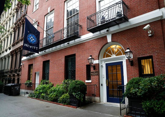 This July 11, 2019, photo, shows the Hewitt School, an all-girls' school located blocks from Financier Jeffrey Epstein's Upper East Side mansion in New York. In the decade since striking a plea deal that required Epstein to register as a child sex offender, he has sought to underwrite all manner of youth causes. Some donations, including $15,000 to the school, were returned once recipients learned where they came from.