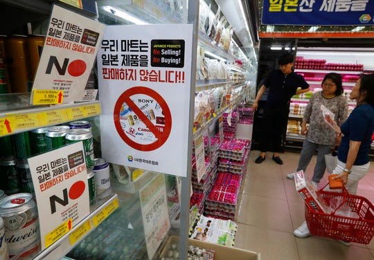 In this Tuesday, July 9, 2019, file photo, notices campaigning for a boycott of Japanese-made products are displayed at a store in Seoul, South Korea.
