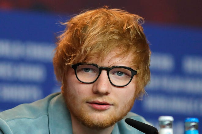 In this Friday, Feb. 23, 2018 file photo, singer-songwriter Ed Sheeran speaks during a press conference in Berlin. Ed Sheeran has confirmed for the first time that he and long-time girlfriend Cherry Seaborn are married. British media have reported that the pair wed before Christmas in front of about 40 friends and family.