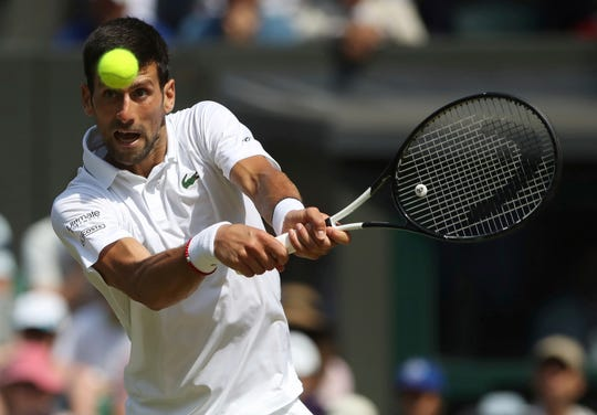 Novak Djokovic returns in his win over Roberto Bautista Agut in the first semifinal on Friday.