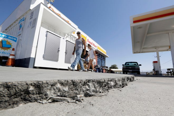 A crack in a gas station's driveway in the aftermath of an earthquake in Trona, Calif.