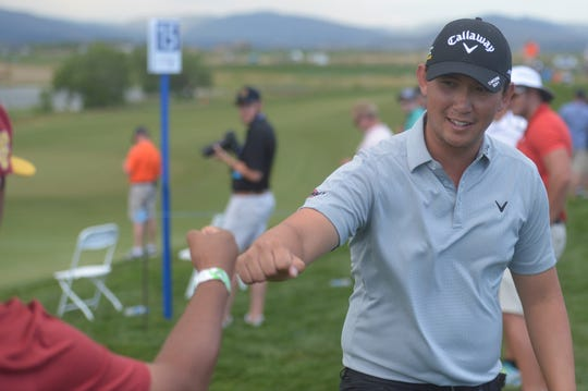 Rico Hoey fist-bumps a fan during Friday's second round of the TPC Colorado Championship at Heron Lakes in Berthoud. Hoey has played tournaments 13 weekends in a row as he tries to make the PGA Tour.