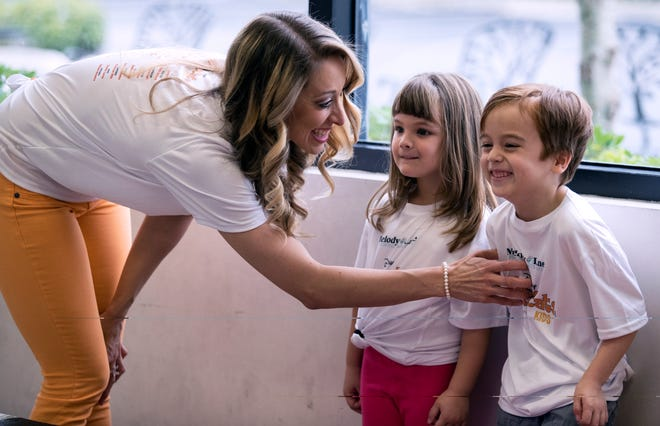 Melody Lane Performing Arts Center co-owner and director Sami Doherty interacts with Dylan Alvarez, 5, and Kaitlin Onstad, 6, during a dance sequence rehearsal.