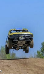 A truck makes a jump in a test run in May at the Dirt City Motorplex at Lena, which will host the its first major event, the Dirt City Duel, on July 27-28.