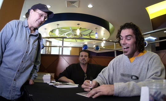 "Evie Hammen, left, of Little Chute gets an autograph from Evan Marriott of TV""s ""Joe Millionaire""  in 2013 at Oneida Bingo & Casino."