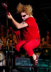 Sammy Hagar leaps during his performance at Oneida Casino Pavilion Nights on July 18, 2006.