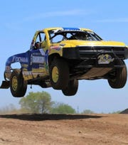 A truck is seen making a jump in late May at a test day at the Dirt City Motorplex, an off-road race facility at Lena. The new track will host its first major event, the Dirty City Duel, on July 27-28.