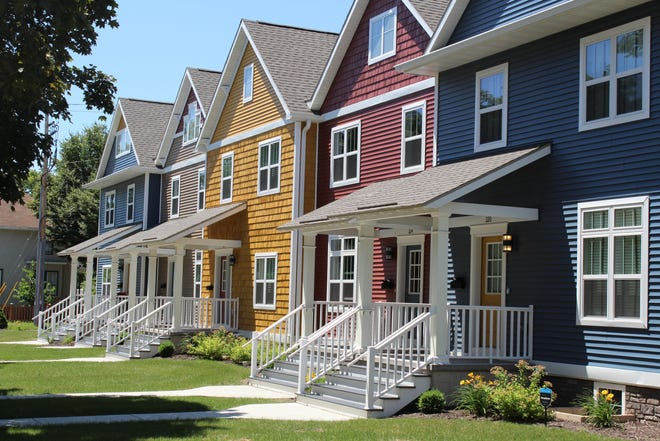 A file photo of townhouses in the 200 block of Jackson Street, in Green Bay. NeighborWorks Green Bay built the homes in 2018 to increase the availability of affordable housing in the Green Bay area.