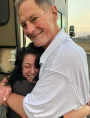 Drew Dobson hugged by his granddaughter, Finley, immediately after walking out of the Federal Correctional Institution in Butner, North Carolina, seen in the background.