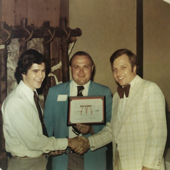 In 1976, Bill Himmelberg of Great Falls (center) received a prestigious award from the McDonald's Corporation. The award was given to only the top one percent of all McDonald's employees that year.