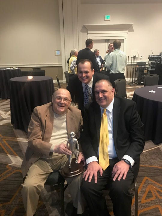 Three generations of the Himmelberg family, including Bill Jr. (seated left), Bill III (seated right) and Bill IV, or Joey (standing) were present to accept an award at a McDonald's corporate banquet late last year.
