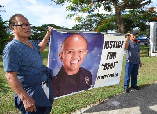 Pete Decipulo, left, the uncle of slain Guam Police Department officer Sgt. Elbert Piolo, rallies for the justice of his nephew with Roger Asistores, a friend of Piolo, in Hagåtña July 12.