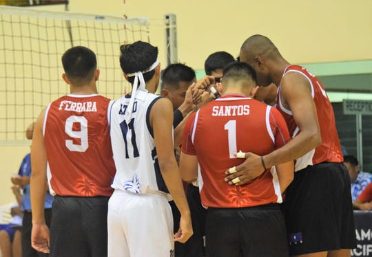 Team Guam gathers for a final huddle before taking on the giants of Samoa July 11 at the Pacific Games in Samoa.