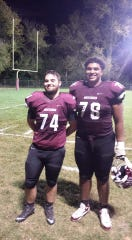 Lifelong friends Jamie Parker (left) and Tristan Wirfs pose after a Mount Vernon football game. They met in second grade and bonded over sports.