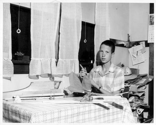As a young Fairfax farm boy, Don Gurnett built award-winning model airplanes at the kitchen table, as shown in this 1956 photo.