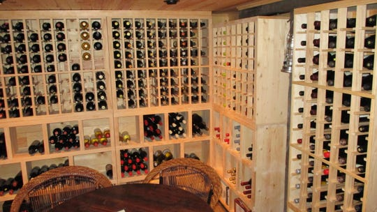 The win cellar at the Tuscan Moon Grill on Fifth is filled with wine cabinet built  by owner Warren Miller.