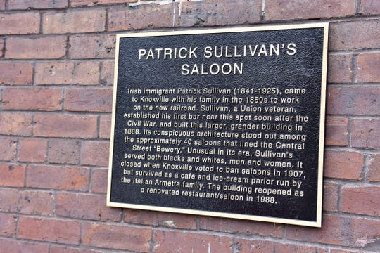 A plaque on the outside of the Lonesome Dove Western Bistro states the history of Patrick Sullivan's saloon.