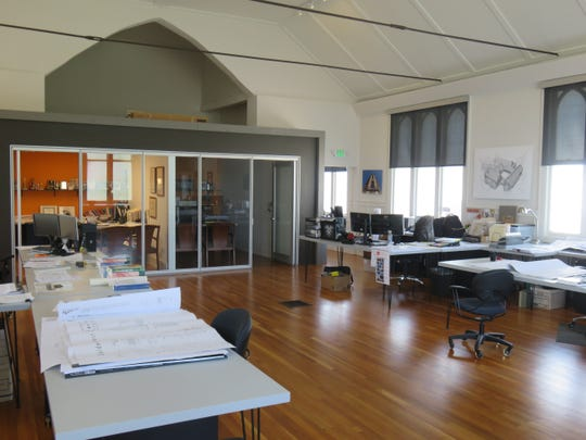 Former sanctuary has work space for several architects.